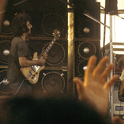 Jerry Garcia performing with The Grateful Dead Live at Dillon Stadium, Hartford, CT 31 July 1974. Featuring the Wall of Sound. Jerry interacting with Bob Weir (out of view) across the stage.