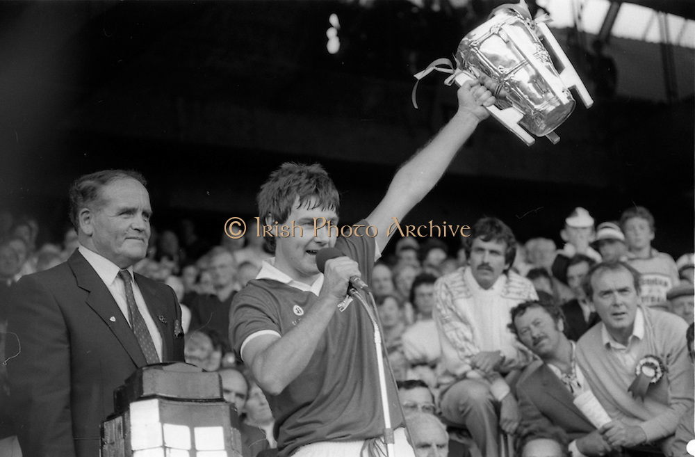 07/09/1986<br /> 09/07/1986<br /> 7 September 1986<br /> All-Ireland Senior and Minor Hurling Finals at Croke Park, Dublin.<br /> Dr. Michael Loftus (left), President of the G.A.A., presents the Liam McCarthy Trophy to Tom Cashman, captain of the Cork team.
