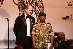 Julius Obwona receives the Tusk Wildlife Ranger Award from the Duke of Cambridge during the Tusk Conservation Awards at Banqueting House, London.
