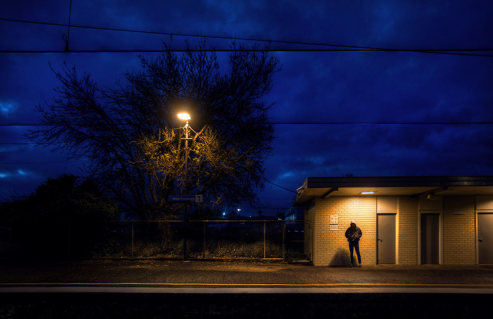 Railway Stations at night. West Footscray. About 6pm and a hooded young man is the only person on the station. Pic By Craig Sillitoe CSZ/The Sunday Age/The Age iPad App.15/6/2011 This photograph can be used for non commercial uses with attribution. Credit: Craig Sillitoe Photography / http://www.csillitoe.com<br /> <br /> It is protected under the Creative Commons Attribution-NonCommercial-ShareAlike 4.0 International License. To view a copy of this license, visit http://creativecommons.org/licenses/by-nc-sa/4.0/.