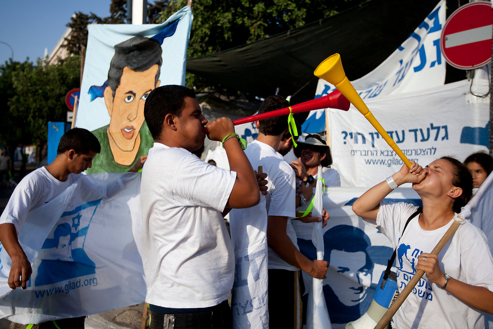 Supporters of Israeli captured soldier Gilad Shalit, calling for his release, use vuvuzelas as they demonstrate outside a protest tent near Prime Minister Netanyahu's residence in Jerusalem on August 4, 2010.