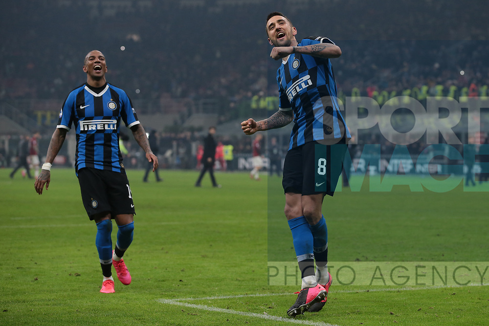 Matias Vecino and Ashley Young of Inter celebrate after the final whistle of the Serie A match at Giuseppe Meazza, Milan. Picture date: 9th February 2020. Picture credit should read: Jonathan Moscrop/Sportimage