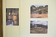 Photos of the bunkers containing 15 million pounds of M6 at Camp Minden are displayed on a wall during a meeting with the EPA, Army and local residents to discuss the disposal of the M6 in Minden, Louisiana on March 11, 2015. (Cooper Neill for The New York Times)