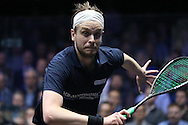James Willstrop of England (wearing a Dark Blue shirt) in action during his match against Paul Coll of New Zealand . Canary Wharf Squash Classic 2016 , day two at the East Wintergarden in Canary Wharf , London on Tuesday 8th March 2016.<br /> pic by John Patrick Fletcher, Andrew Orchard sports photography.