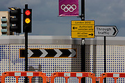 Street landscape near the Westfield City shopping complex, Stratford. On a new stretch of highway recently finished for those circumnavigating the perimeter of the Olympic park and its nearby shopping centre. The outer barrier of the Olympic Park is 2.5 sq km and circles a huge area of the borough of Stratford in the borough of Newham. The new landscape often looks incongruous to those living on many poor estates, excluded from the events. But this regeneration is the legacy by the government who promise a brighter future for this part of east London..