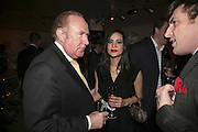 ANDREW NEIL AND RENU SINGH, Barnardo's Christmas champagne reception at The Hospital, Endell Street, WC2 . 12 December 2006. ONE TIME USE ONLY - DO NOT ARCHIVE  © Copyright Photograph by Dafydd Jones 248 CLAPHAM PARK RD. LONDON SW90PZ.  Tel 020 7733 0108 www.dafjones.com