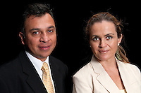 Midde age executive team in black background.