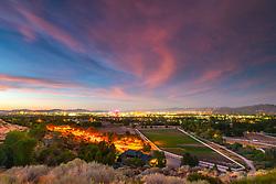 """""""Reno, Nevada Sunset 1"""" - Photograph of a Nevada shaped horse corral and Reno, Nevada shot at sunset."""