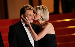 """File photo : """"Johnny Hallyday and Laeticia Hallyday leave the screening of """"""""Vengeance"""""""" at the 62nd Cannes Film Festival. Cannes, France, May 17, 2009. France's biggest rock star Johnny Hallyday has died from lung cancer, his wife says. He was 74. The singer - real name Jean-Philippe Smet - sold about 100 million records and starred in a number of films. Photo by Lionel Hahn/ABACAPRESS.COM"""""""