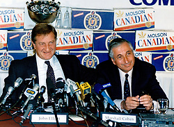 August 1, 2017 - Toronto, ON, Canada - TORONTO, ON: 01/19/1989  -- 50-50 Partners. The huge deal will see Molson and Carling's Australian owners, Elders IXL Ltd., become 50/50 partners. At left is John Elliott, chairman of Elders. Flanking him is Marshall Cohen, president of Molson Companies Ltd. (Credit Image: © Frank Lennon/The Toronto Star via ZUMA Wire)