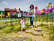 09 JUNE 2018 - IMJINGAK, PAJU, SOUTH KOREA: A South Korean mother and daughter play in the park on the South Korean side of the Korean DMZ in Imjingak. Imjingak is a park and greenspace in South Korea that is farthest north most people can go without military authorization. The park is on the south bank of Imjin River, which separates South Korea from North Korea and is close the industrial park in Kaesong, North Korea that South and North Korea have jointly operated.     PHOTO BY JACK KURTZ