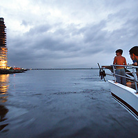 (DAYIN) Barnegat 8/7/1002 Jacob Howell 10 and Jordan Waxman 12 both of PA stand on the pulpit of the Miss LBI as it passes by the Barnegat Lighthouse during an evening sunset cruise.   Michael J. Treola Staff Photographer....MJT
