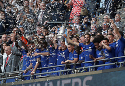Chelsea's Cesar Azpilicueta (centre) lifts the FA Cup trophy with his team-mates