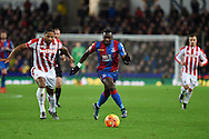 Yannick Bolasie of Crystal Palace makes a break. Barclays Premier league match, Stoke city v Crystal Palace at the Britannia Stadium in Stoke on Trent, Staffs on Saturday 19th December 2015.<br /> pic by Andrew Orchard, Andrew Orchard sports photography.