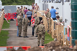 © licensed to London News Pictures. London, UK 19/07/2012. A group of off-duty soldiers spending time outside their accommodation area at the military base in Hainault Country Park in Redbridge, east London. The base will accommodate 3,000 soldiers during the Olympics. Photo credit: Tolga Akmen/LNP