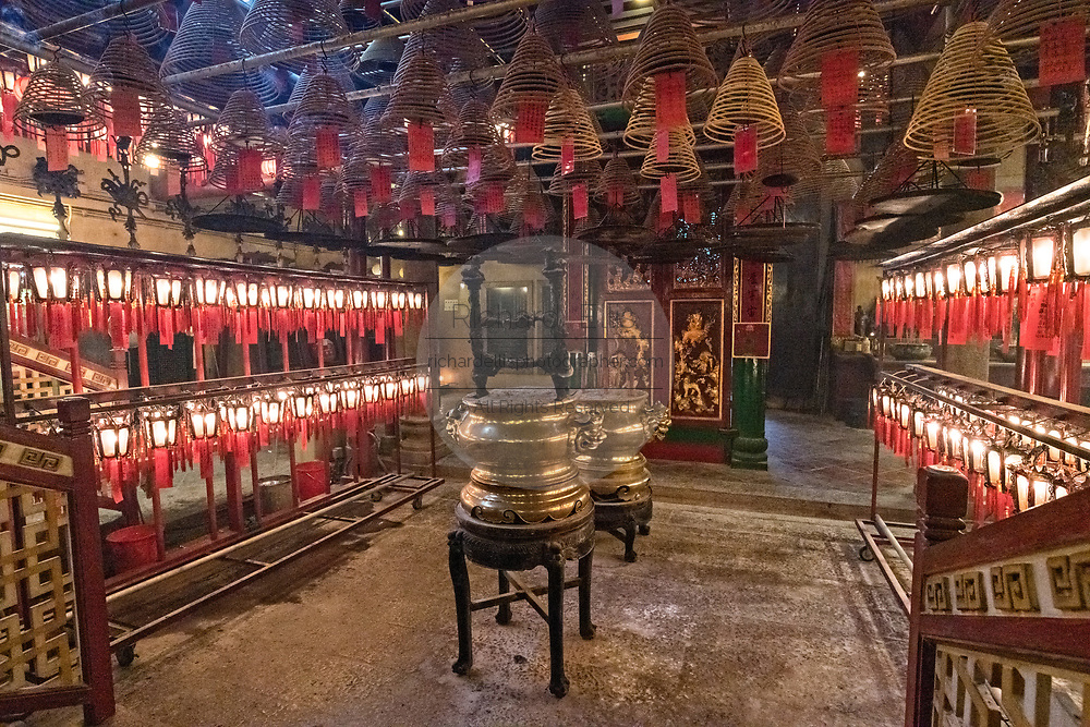 The interior of the Man Mo Temple with giant hanging incense coils is a tribute to the God of Literature and the God of War and was built in 1847 in Sheung Wan District of Hong Kong Island. The Taoist temple is the largest Man Mo Temple in Hong Kong and includes two additional temples for Buddhist and Taoist deities.