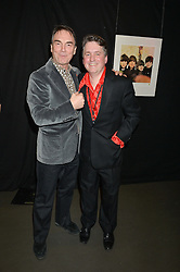 Left to right, SIR ALAN PARKER Chairman of Save The Children and JUSTIN FORSYTH CEO of Save the Children at a Night of Disco in aid of Save The Children held at The Roundhouse, Chalk Farm Road, London on 5th March 2015.