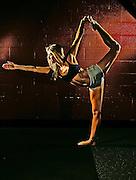 Jana Hare in yoga pose.  Photo by Mark Cornelison