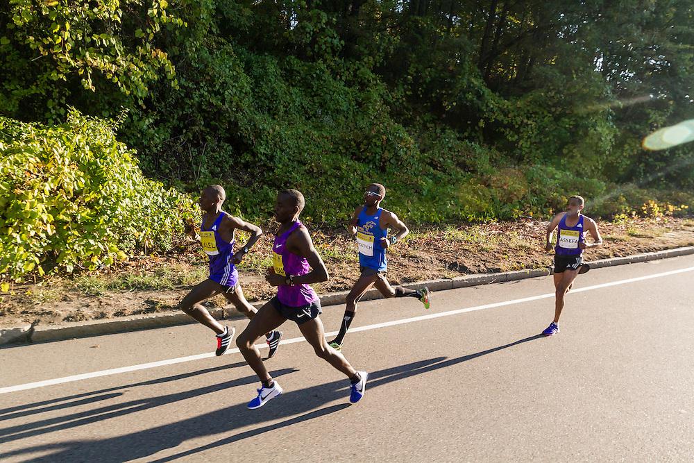 leaders Sambu, Salel, Ngetich and Assefa fly down road a 1 mile