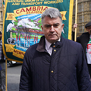 Parliament, London,England,UK. 26th April 2017. RMT President. Mick Cash and Members of the National Union of Rail, Maritime and Transport Workers (RMT) protest outside Parliament, marking the 1st anniversary of industrial action against Southern Rail regarding their proposal to extend (DOO) Driver Only Operation. by See Li
