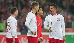 March 27, 2018 - Chorzow, Poland - Tomasz Kedziora, Lukasz Teodorczyk and Poland Arkadiusz Milik of Poland during the international friendly soccer match between Poland and South Korea national football teams, at the Silesian Stadium in Chorzow, Poland on 27 March 2018. (Credit Image: © Foto Olimpik/NurPhoto via ZUMA Press)