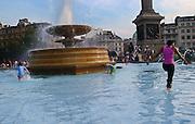 England, London: bathing in Trafalgar square fountain