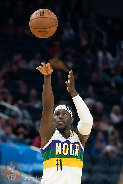 February 23, 2020; San Francisco, California, USA; New Orleans Pelicans guard Jrue Holiday (11) shoots the basketball during the third quarter against the Golden State Warriors at Chase Center.