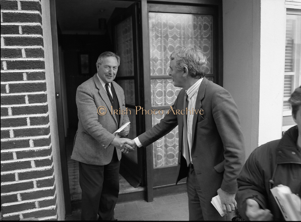 Austin Currie Canvas In Palmerstown (T1)..1989..07.06.1979..06.07.1989..7th June 1989..In the general election The Fine Gael Party chose Mr Austin Currie to contest for a seat in Dail Eireann. Well known as a civil rights activist and peace campaigner Mr Currie hoped to win a seat alongside running mate Mr Jim Mitchell.Mr Currie previously held a seat in the Northern Ireland Executive and held a position as Minister for Housing and Local Planning. Mr Currie is a founder member of the S.D.L.P...On the campaign trail, Mr Currie is pictured going door to door to meet with the voters in his constituency.