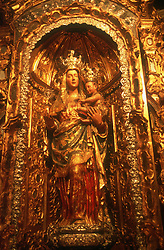 Virgin and Child statue in Seville Cathedral covered with gold leaf,