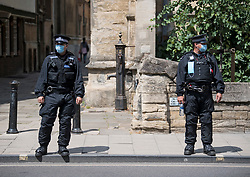 © Licensed to London News Pictures. 09/06/2020. Oxford, UK. Police wearing face masks outside Oriel College at Oxford University, where a demo will be held later by campaigners calling for the removal of a statue of controversial imperialist Cecil Rhodes. Black Lives Matter protesters recently pulled down a statue of slave trader Edward Colston in nearby Bristol Town centre, following the death of George Floyd in the U.S.A . Photo credit: Ben Cawthra/LNP