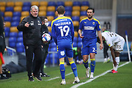 AFC Wimbledon manager Glyn Hodges holding ball and pointing during the EFL Sky Bet League 1 match between AFC Wimbledon and Milton Keynes Dons at Plough Lane, London, United Kingdom on 30 January 2021.