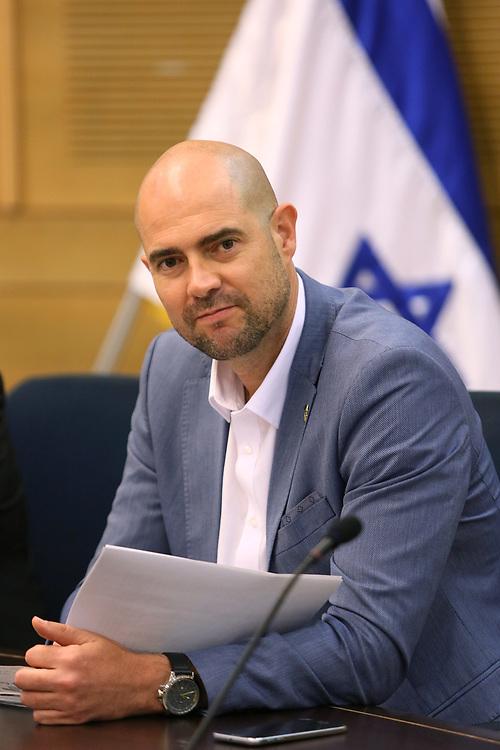 Israeli lawmaker, Member of the Knesset Amir Ohana at the Knesset, Israel's parliament in Jerusalem, on June 7, 2016.