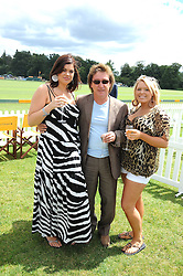 Left to right, CHLOE MARSHALL, KENNEY JONES and his daughter  at the 2008 Veuve Clicquot Gold Cup polo final at Cowdray Park Polo Club, Midhurst, West Sussex on 20th July 2008.<br /> <br /> NON EXCLUSIVE - WORLD RIGHTS