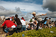 Supporters of ousted Honduran President Manuel Zelaya, clash with the soldiers during a protest against the military coup near Toncontin international airport in Tegucigalpa on July 5, 2009.