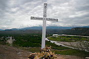 """A cross remember the peoples who dies at the """"La curva del diablo"""", devils curves near to Bagua, Amazonas, Peru. After the events of June 5 in the Amazonian province of Bagua, in northeastern Peru, where 24 policemen and a number still not confirmed of natives from the communities of the ÒAlto Mara-onÓ and civilians died in clashes after a series of demonstrations in opposition to the approval by the Peruvian government, for a group of ordinances that allow large flexibility in the restrictions on resource extraction in the area, breaking the 169 agreement of ILO (International Labour Organization), which requires the consultation of indigenous communities about the exploitation of nature in their territories. One of the most active communities was the awajun, a warlike and revengeful people, heritors of the Jibaros and recently contacted near to 1950. For the leader or """"apu"""" for one of the aguarunas riverside communities of the Mara-on, Simon Weepiu, Òthe force of this movement come from the conviction of the struggle, which is caused by the ancestral development as based on worldview, which provides the native of a special power, that of becoming one with his idea and his brothers, to focus all on the same objective and be just a great strength."""" The government aims to generate development in the area allowing the exploitation of property, The jungle is rich in gold and oil, and even argue that natural wealth of the region belong to all Peruvians, and not just the communities that inhabit it, but acts as the oil«s filtration to waters of the Mara-on, left in evidence that in a complex ecosystem like jungle that mixed spilled oil by rain in the river, home to fishes, as well as the waters that irrigate cassava, bananas, sugarcane and other elements vital to the development of communities. The natives, insist that the forest is not only home, is where they get medicines to cure their sick and food for their families. The pre-existence and natural wisdom places them"""