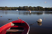 Boats on the estuary near the river mouth in St Dogmaels, Pembrokeshire, Wales, United Kingdom. St Dogmaels is a village, parish and community in Pembrokeshire, Wales, on the estuary of the River Teifi, a mile downstream from the town of Cardigan in neighbouring Ceredigion. A little to the north of the village, further along the estuary, lies Poppit Sands beach.