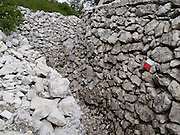"""Hike scenic and historic trails around Cinque Torri in the Dolomiti Ampezzane mountains near Cortina d'Ampezzo, Italy, Europe. Explore restored artillery bunkers and trenches from World War I conflicts between Italian and Austro-Hungarian troops. The """"Five Towers"""" (Cinque Torri or Fünf Türme) rise to 2361 meters elevation on Averau mountain in the Nuvolao group of the Dolomites. The Dolomites were declared a natural World Heritage Site (2009) by UNESCO."""