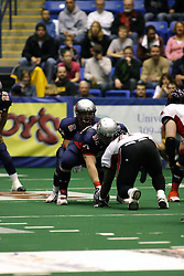 14 April 2007: Quarterback Steve LaFalce readies for the hike from center Luke Wickman during a United Indoor Football League game that pitted the RiverCity Rage who won 29-11 against the Bloomington Extreme at the U.S. Cellular Coliseum in Bloomington Illinois..
