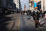 With local coronavirus lockdown measures in place and Birmingham currently set at 'Tier 2' or 'high', people, many of whom are wearing face masks walk along the busy end of Corporation Street in the city centre on 26th October 2020 in Birmingham, United Kingdom. The three tier system in the UK has levels: 'medium', which includes the rule of six, 'high', which will cover most areas under current restrictions; and 'very high' for those areas with particularly high case numbers. Meanwhile there have been calls by politicians for a 'circuit breaker' complete lockdown to be announced to help the growing spread of the Covid-19 virus.