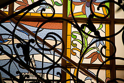Wrought-iron railing and art, Cuenca, Ecuador, South America.   Cuenca is a UNESCO World Heritage Site.