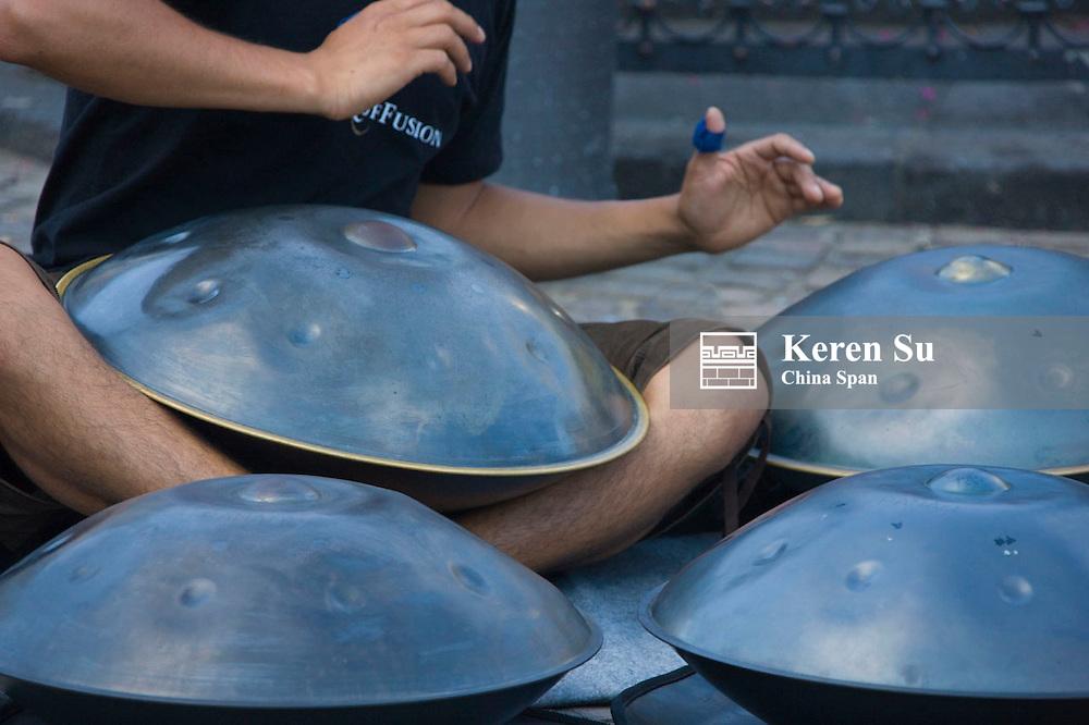 Beating a drum-like music instrument, Frankfurt, Germany
