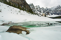 An early spring visit to Moraine Lake in Banff National Park. The lake was still mostly frozen over and ther was plenty of snow on the ground.<br /> <br /> ©2014, Sean Phillips<br /> http://www.RiverwoodPhotography.com