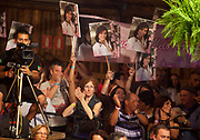 Families and crowd, holding banners and watching the music at Reponte da Cancao music festival and song competition in Sao Lorenzo do Sul, RIo Grande do Sul, Brazil.