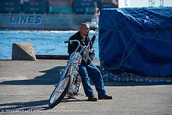 "Aki Sakamoto with his 1968 HD XLCH Ironhead ""KAU'I"" at the docks before the Mooneyes Yokohama Hot Rod & Custom Show. Yokohama, Japan. December 5, 2015.  Photography ©2015 Michael Lichter."