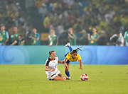 Beijing, CHINA.   Olympic Football, Women's Gold  Medal Game, USA vs BRA, left  USA's.  Carli LLOYD and right, Brazils, ERIKA   at the Beijing Workers Stadium. Thursday,  21.08.2008 [Mandatory Credit: Peter SPURRIER, Intersport Images]