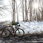 Competitors in action during the Newtown CX, Cyclocross Event in mud and melting snow. The event was organized by The Connecticut Cycling Advancement Program and Team 26, a group of cyclists affected by the tragedy at Sandy Hook School. Fairfield Hills, Newtown, Connecticut, USA. 21st December 2013. Photo Tim Clayton