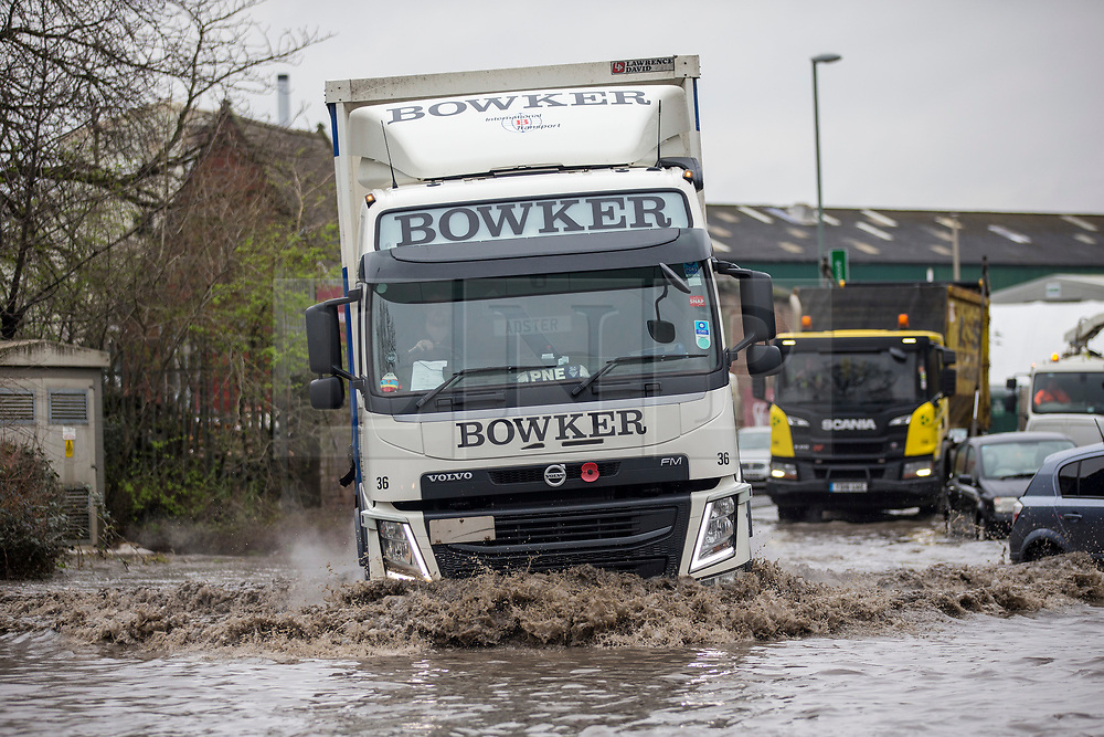 © Licensed to London News Pictures. 06/03/2019. Leeds UK. A lorry struggle's through flood water in Leeds this morning. Heavy rain last night has caused flooding in Leeds this morning leaving cars abandoned in flood water on Knowsthorpe Lane in the Cross Green area of the city. Photo credit: Andrew McCaren/LNP