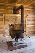 Old wood fired stove in the Gregg-Cable house, at Cable Mill Historic Area, Cades Cove, Tennessee. Cades Cove, once home to numerous settlers, is an isolated valley located in Great Smoky Mountains National Park, USA. Today Cades Cove is the most popular destination for visitors to the park, attracting over two million visitors a year, due to its well preserved homesteads, scenic mountain views, and abundant display of wildlife.