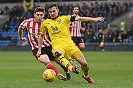 Oxford United defender Jamie Hanson (6) clears from Sunderland midfielder Lynden Gooch (11) during the EFL Sky Bet League 1 match between Oxford United and Sunderland at the Kassam Stadium, Oxford, England on 9 February 2019.