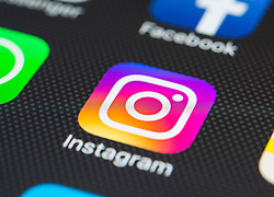 Instagram social  media app close up on iPhone smart phone screen